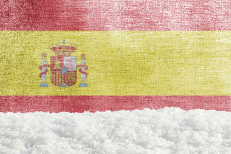 Winter grunge background with snowdrift and Spanish flag in the backdrop Banco de Imagens
