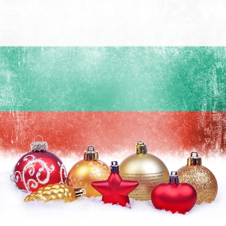 Christmas grunge background with festive decorations-balls, star, heart, fir cone and Bulgarian flag