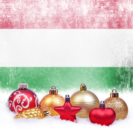 Christmas grunge background with festive decorations-balls, star, heart, fir cone and Hungarian flag Foto de archivo