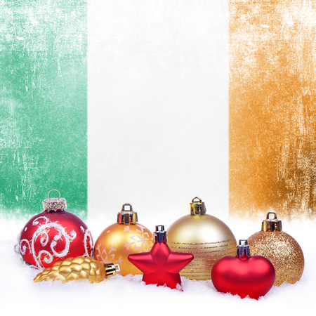Christmas grunge background with festive decorations-balls, star, heart, fir cone and Irish flag
