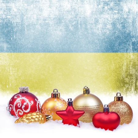 Christmas grunge background with festive decorations-balls, star, heart, fir cone and Ukrainian flag