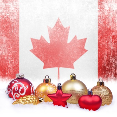 Christmas grunge background with festive decorations-balls, star, heart, fir cone and Canadian flag Stock Photo