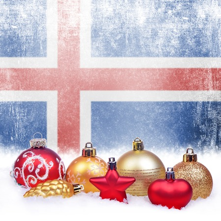 Christmas grunge background with festive decorations-balls, star, heart, fir cone and Icelandic flag Stock Photo
