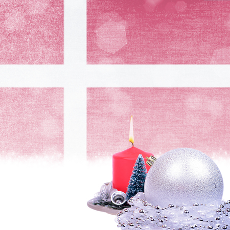 Christmas card with red candle, silver ball, fir-tree over grunge Danish flag