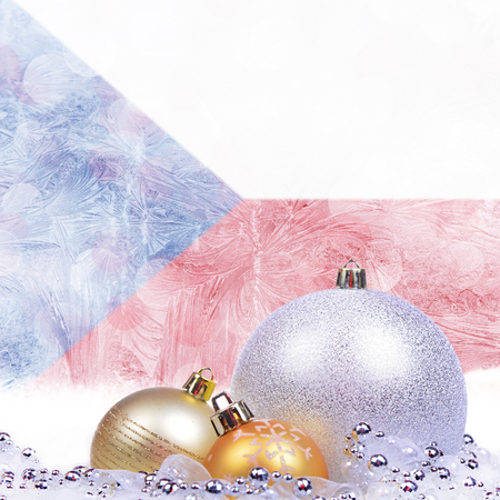Christmas background with Czech Republic flag on frosted windowpane, big silver ball and golden balls Reklamní fotografie