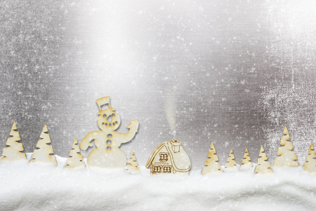 Christmas background. Fairy village, snowman in the winter forest and snowfall 免版税图像