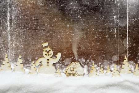 Christmas background. Fairy village, snowman in the winter forest and snowfall Stock Photo