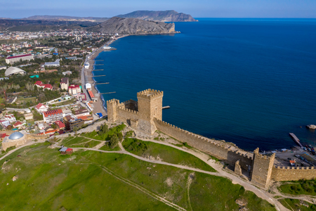 Genoese fortress in the Sudak bay on the Peninsula of Crimea. Aerial drone view Фото со стока - 128310228