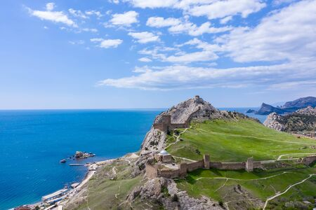 Genoese fortress in the Sudak bay on the Peninsula of Crimea. Aerial drone view