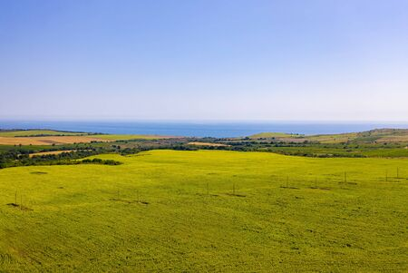 Agricultural landscape with a large sunflower field on the Mediterranean coast. Aerial drone shot Standard-Bild - 128818690