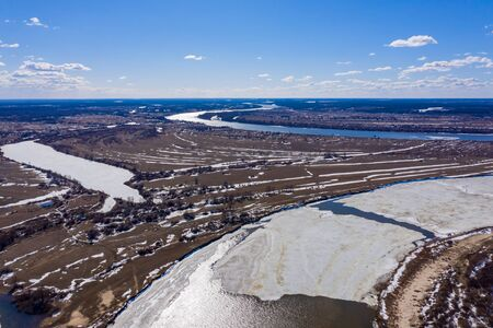 Flying drone over the ice floating on the river Oka, Russia Standard-Bild - 131955805