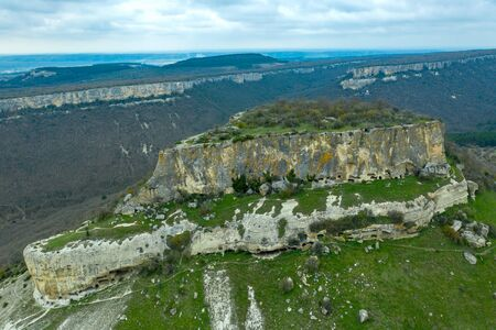 Cave city Tepe-Kermen, near the city of Bakhchisaray, Crimea. Aerial drone shot Standard-Bild - 133062650