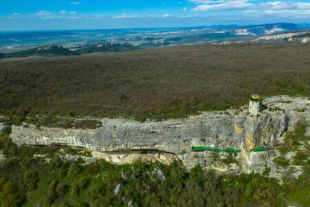 Flying drone above the cave city and monastery Shuldan, near the city of Bakhchisaray, Crimea Standard-Bild - 133062903