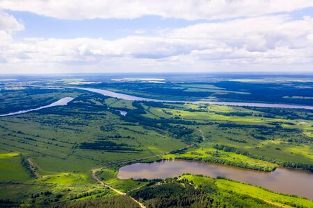 Big river and flood meadows. Aerial drone view Standard-Bild - 131954965