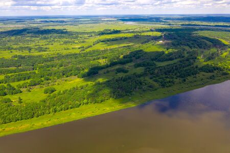 Big river and flood meadows. Aerial drone view Standard-Bild - 131954821