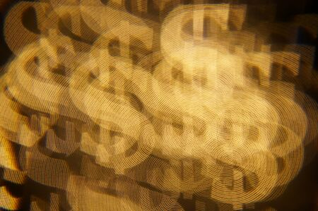 Dollar bokeh lights. Abstract financial background with many dollar symbols.