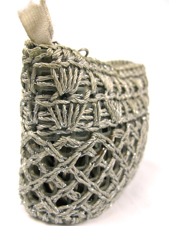 Silver weaved coin purse isolated on white photo