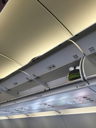 payphone: Aircraft overhead luggage compartment
