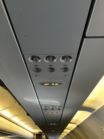 controls: Aircraft Cabin overhead lights controls Stock Photo