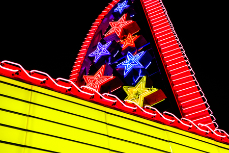 movie theater marquee with neon lights at night