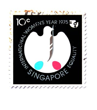 20 years old: International WomenYear 1975, old postage more than 20 years old of Singapore Stock Photo