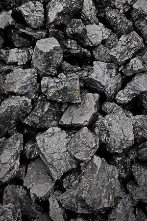 awaiting: Coal mining in Borneo awaiting shipment to the factory. Stock Photo