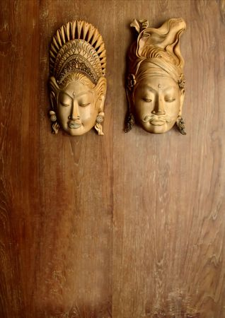 clues: pair of carved statues for clues male and female rest rooms Stock Photo