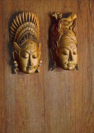 handwork: pair of carved statues for clues male and female rest rooms Stock Photo