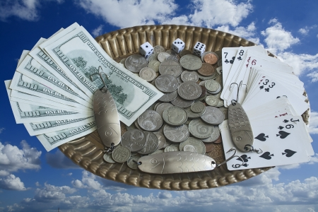 Still life - collage with money on a bronze tray, flying in the sky.