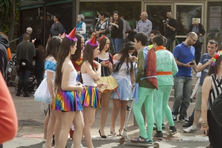 esther: Purim in Israel. People walking on the festive streets. Editorial