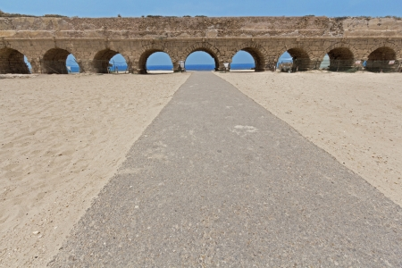 The ancient viaduct on the Mediterranean Sea. Israel.