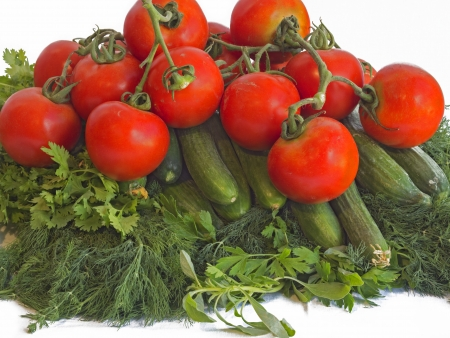dill leaves: Tomatoes, cucumbers, dill leaves and parsley on the white background. Stock Photo