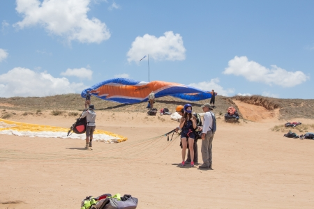 A camp of Para-gliders  Para-gliders met on the beach   Editorial