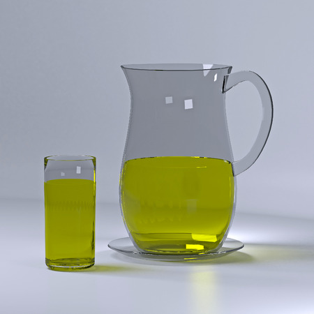 Glass pitcher and cup of lemonade. Stock Photo