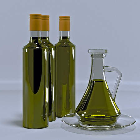 Glass jug and three bottles of olive oil. Stock Photo