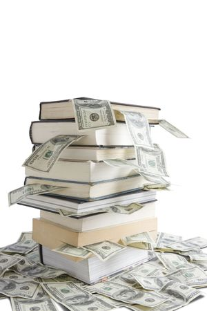 Books stacked on  top of one hundred dollar bills