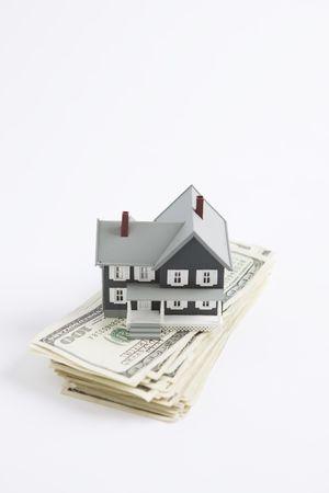 bankroll: Model Home on top of One Hundred Dollar Bills  Stock Photo