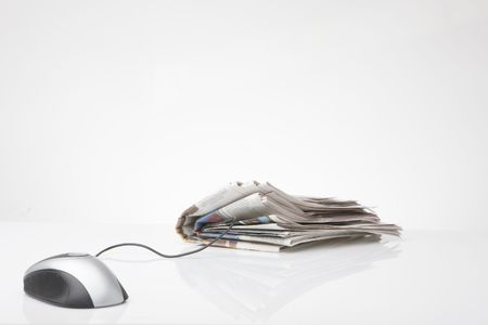 computer mouse connected to newspaper  Stock Photo