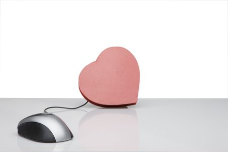 admire: computer mouse connected to red heart  Stock Photo