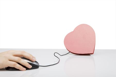 hand on computer mouse connected to red heart  Stock Photo