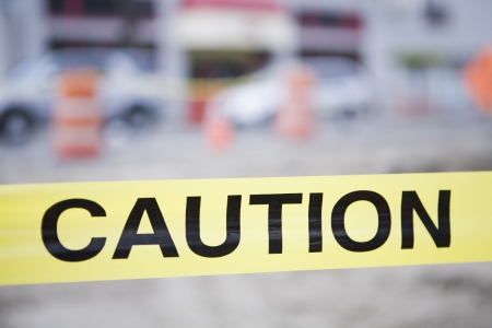prevented: select focus of caution tape at construction site  Stock Photo