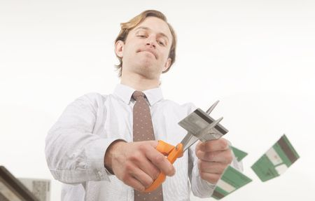 unique perspective of person cutting credit cards