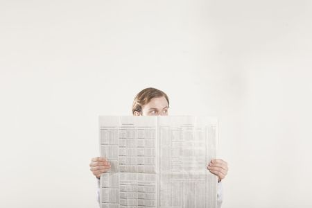 financial newspaper: man reading financial section of newspaper  Stock Photo