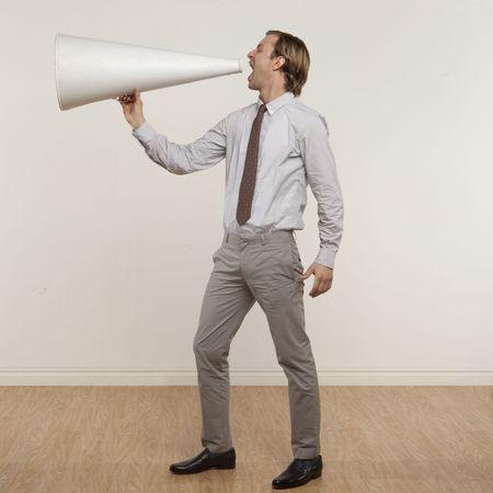 professional man yelling through megaphone