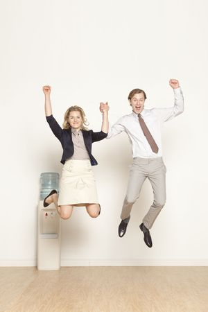 male and female professional happy and jumping  Stock Photo