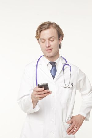 portrait of a doctor text messaging  Stock Photo - 5046782