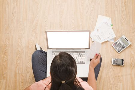 overhead shot: overhead shot of woman sitting on floor with laptop