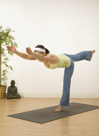peron: woman in a traditional yoga pose  Stock Photo