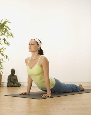 woman in a traditional yoga pose  Banco de Imagens
