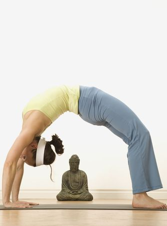 woman in a traditional yoga pose Stock Photo - 5350317